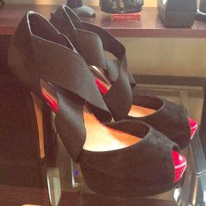 Red peep toe black heels